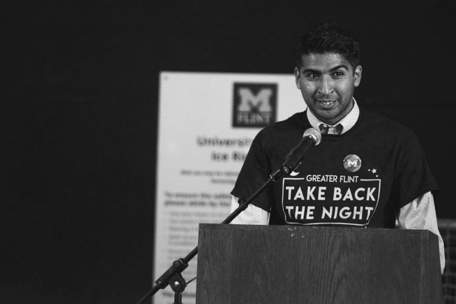 Flint+City+Councilman+and+UM-Flint+students+Santino+Guerra+speaks+at+Take+Back+The+Night+on+Sept.+24.