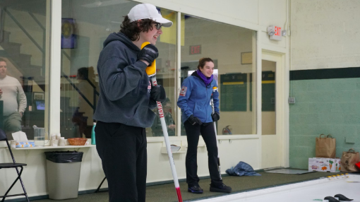 "Hebert and Tschumakow smile during their practice. They are holding the brooms as they had just finished their turn. ""We've practiced and worked on building processes for everything. Stick to the plan and remember your processes,"" Benton said."