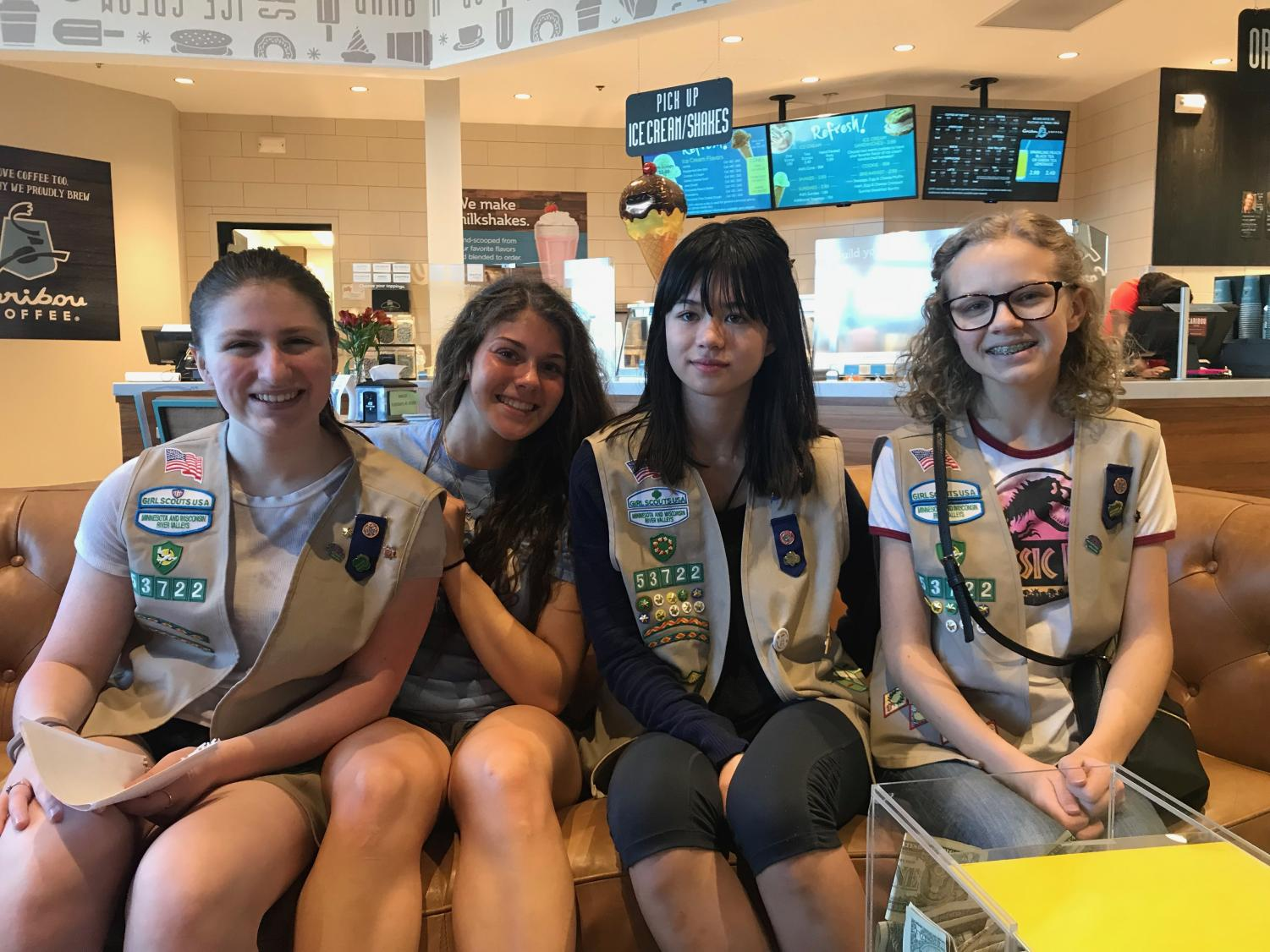 Juniors Emily Shanley and Johanna Teegarden smile big with other Girl Scouts for their leader. Teegarden and Shanley have been in Girl Scouts together since first grade.
