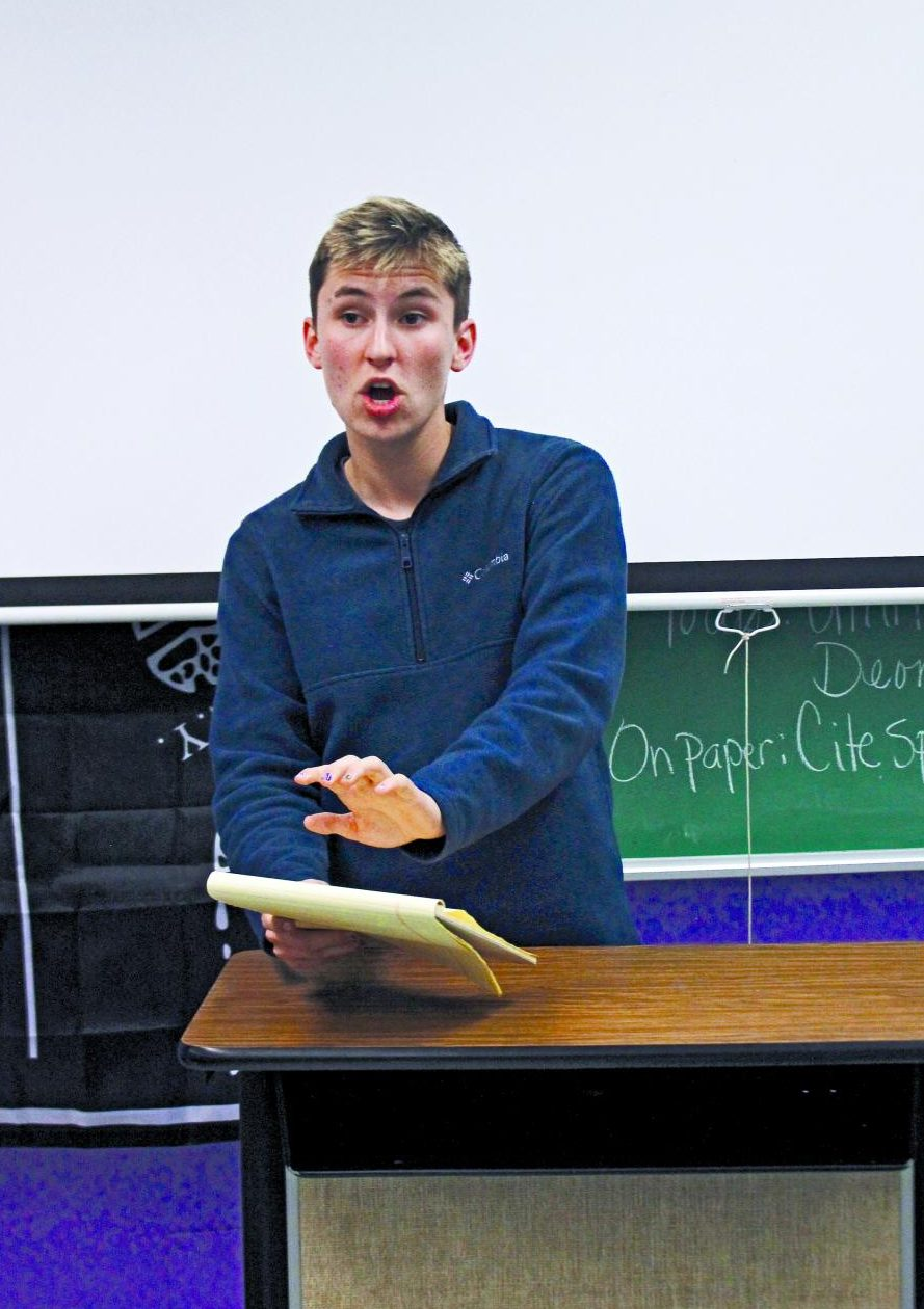 FIRM VOICE: Taking a stance, junior Nick Van Lente argues about current events in front of the debate class. Van Lente has been interested in debate ever since a teacher suggested he would be a good fit for the class.