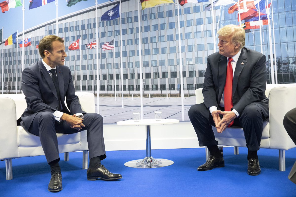 French President Emmanuel Macron and U.S. President Donald Trump converse at the 2018 NATO summit. At this past summit in December, a video went viral that showed world leaders joking about President Trump.