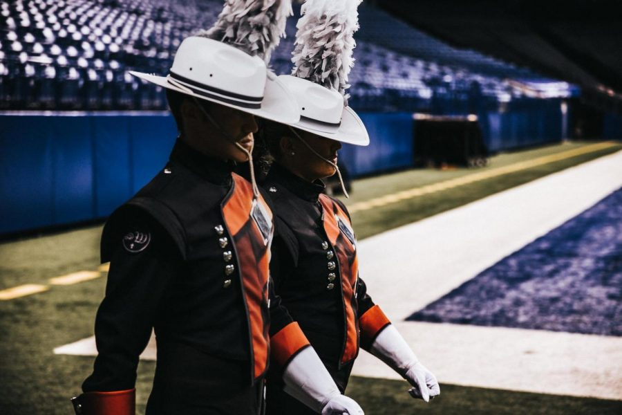 2014+graduate+Spencer+Holyoak+walks+into+a+stadium+as+drum+major+for+the+Crossmen+Drum+and+Bugle+Corps.