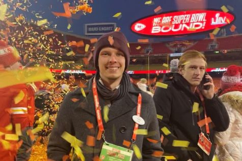 2015 Randall graduate Ryan Larson stands on the field after the Kansas City Chiefs defeated the San Francisco 49'ers at the Super Bowl.