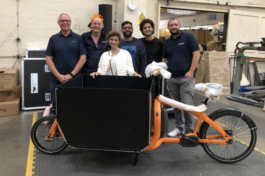Fareh+Asemi+%28P%2711%29+poses+with+the+assembly+team+of+a+prototype+of+the+ecofleet+bike.+ecofleet+is+a+new+carbon+neutral+delivery+company+based+in+London.+
