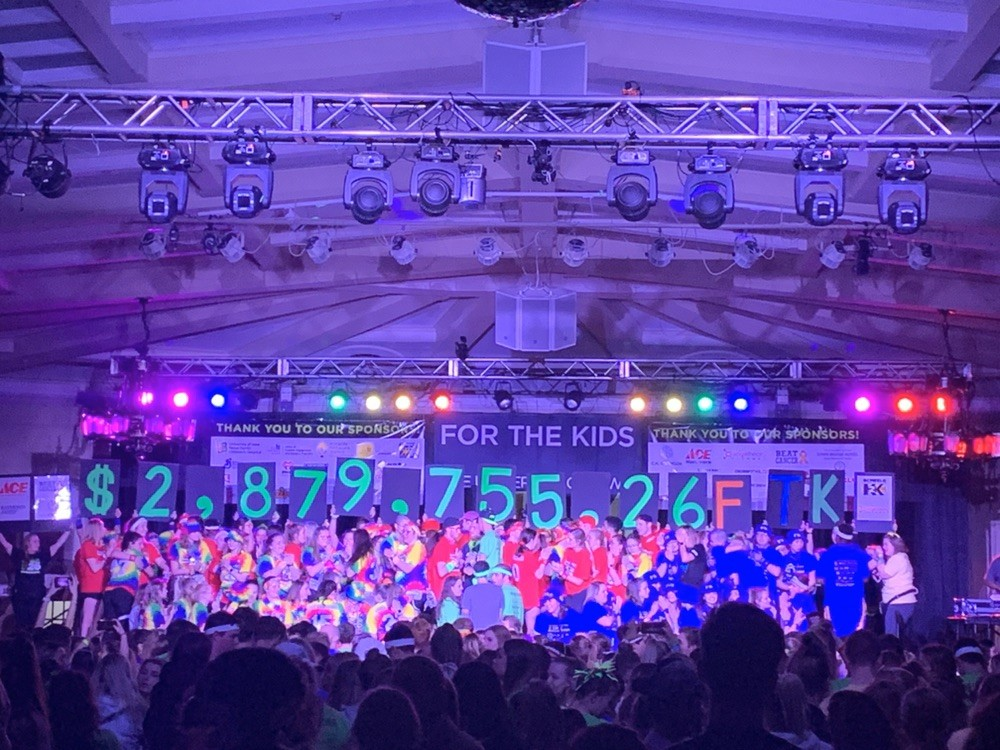 The final reveal for the amount of money raised for the kids is celebrated.