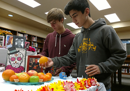 For Dual Credit Spanish IV, juniors Colton Amaya and James Mendez set up an ofrenda in the library. The ofrenda served as a school celebration of Dia de los Muertos,