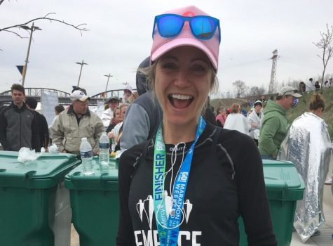 Jackie Pirtle-Hall, moments after the St. Louis Go Marathon race showing off her first place medal. All smiles knowing she qualified for the Olympic trials.