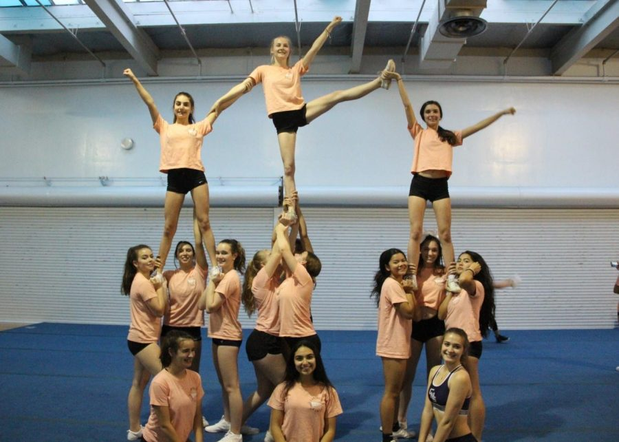 Carlmont+competition+cheerleaders+are++warming+up+before+practice+in+a+complex+pyramid.