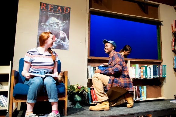 """Senior Caleb Mosley (right) talks with junior Brenna Collins (left) during a performance of """"Middletown."""" Along with his theatrical feats, Mosley also plays varsity basketball."""