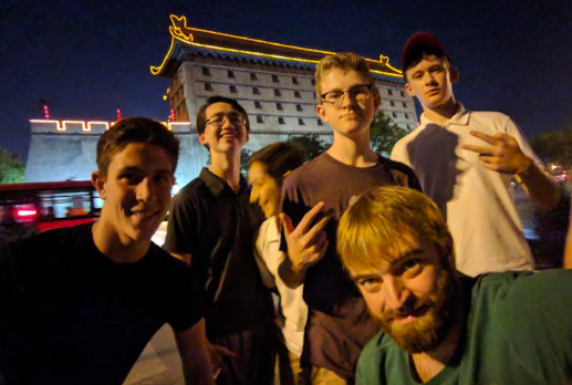 Sophomores Luciano Sebastianelli, Keita Wiliams, Devin Dicarlo, Andrew Boyer, Lucas Thompson, and WMS teacher Brian Reddington pose infront of a building in the city of Xi'an on the China trip.