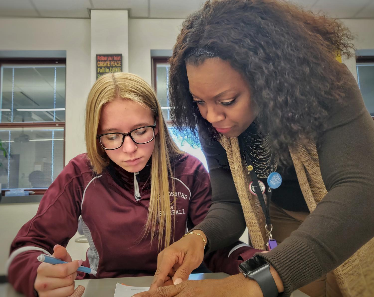 Mrs. Nadine Edwards works with student Kaela Van Horn in her Fundamentals of Math class at Stroudsburg High School.