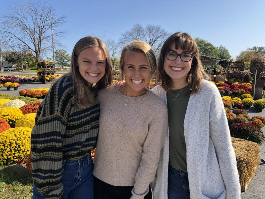 Sophomore Camryn Woods(left) posing with her 2 sisters that helped start their successful business called 3 Thrifty Sisters.