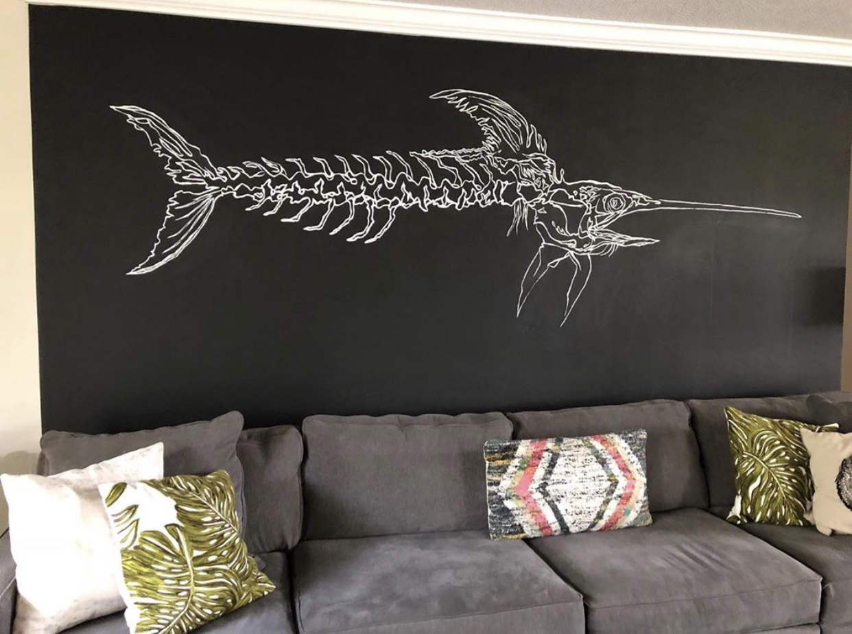 The mural senior Luke Shaw painted in a family friend's living room that started his company.