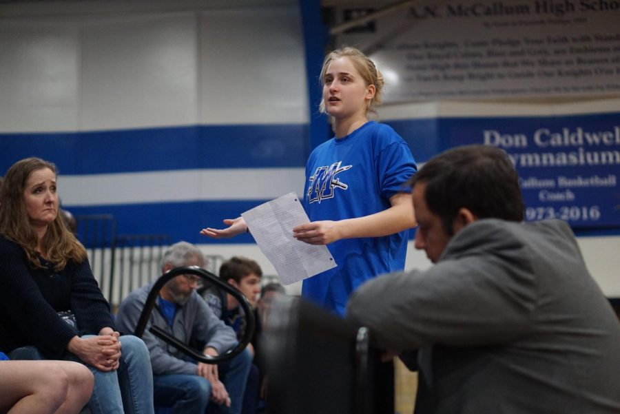 Girls+varsity+basketball+team+captain+Ruby+Del+Valle+speaks+at+the+Jan.+21+meeting.+She+argued+against+the+removal+of+the+banner.+Photo+by+Gabby+Sherwood.