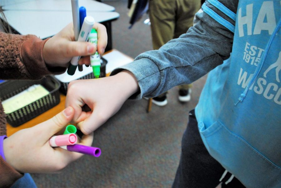 Student council members marked the middle schoolers  hand while they got into the line for lunch.