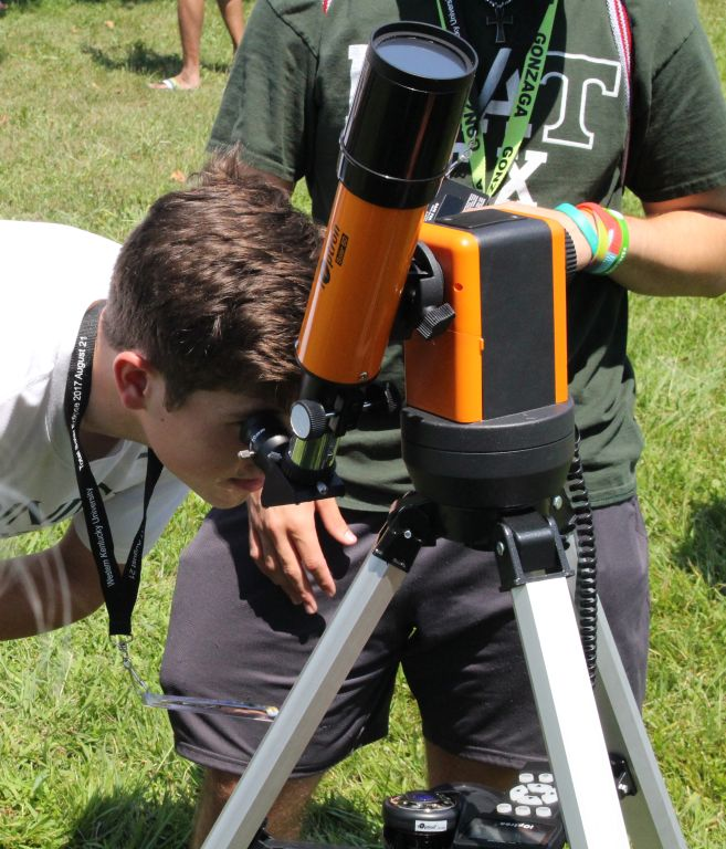 Scanning+the+heavens+--+Trinity+students+gaze+through+a+telescope+during+the+Aug.+11%2C+2018%2C+solar+eclipse.+