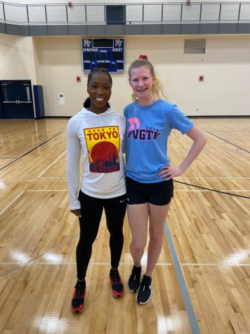 Junior Harmony Creasy poses for a picture with Tianna Bartoletta after the 'Why You're Not a Track Star' workshop at PVHS