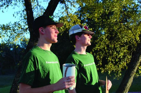 PROUD FACES: Juniors Atticus Kohler and Caden Cooper look out at their little league team with proud smiles. The two co-coach the Emerald Team at Oak Hill.