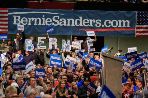 Sanders supporters hold up signs spelling out the Vermont senator's name at his rally at Roy Wilkins Auditorium on March 2, 2020.