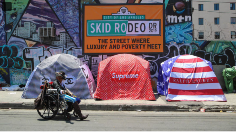 A+woman+supports+the+helpless+on+overpopulated+street+of+Skid-Row.%0A%0A++++++++++++++++++++++