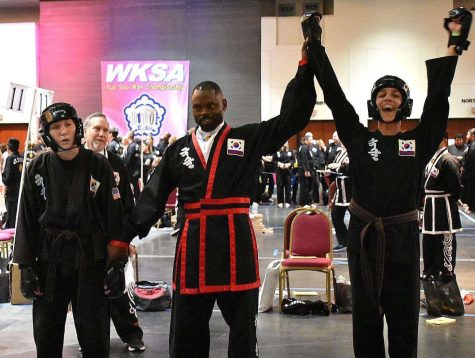 Simpkins competed in the WKSA Kk Sool Won Championship in Galveston, Texas. An official raises Simpkins' arm, signaling his triumph over the opponent.