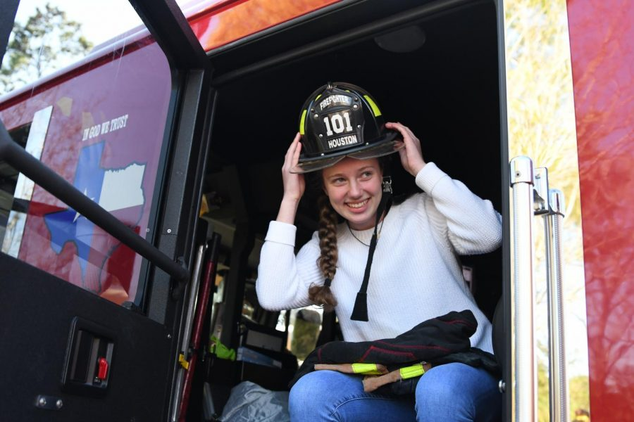 Sophomore+Kate+Tiedtke+sits+in+a+Houston+Fire+Station+101+fire+truck+on+Feb.+21.+After+going+into+cardiac+arrest+Kate+visited+the+firefighters+often+to+sit+and+talk+with+them.+%E2%80%9CThe+experience+to+thank+the+firefighters+was+one+of+a+kind%2C%E2%80%9D+Kate+said.+%E2%80%9CThey+never+get+the+appreciation+they+deserve.+During+their+job+they+see+the+worst+things+in+life+like+people%E2%80%99s+death+and+their+suffering.+It+is+very+hard+for+them+to+be+happy+sometimes+because+of+this.+At+the+reunion%2C+they+all+looked+so+happy%2C+and+that+is+all+I+would+ever+want+for+them%2C+because+they%E2%80%99re+like+friends+to+me.%E2%80%9D
