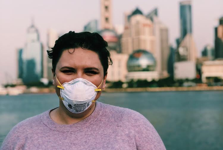 Summer+Creek+graduate+Sarah+Smithson+stops+by+the+Bund+in+Shanghai+to+take+a+photo.+The+usually+crowded+tourist+attraction+was+almost+empty+because+of+the+coronavirus+outbreak.+Smithson+has+spent+much+of+the+past+two+months+in+her+apartment+in+Shanghai+since+the+school+she+teaches+at+had+to+temporarily+close+because+of+COVID-19.