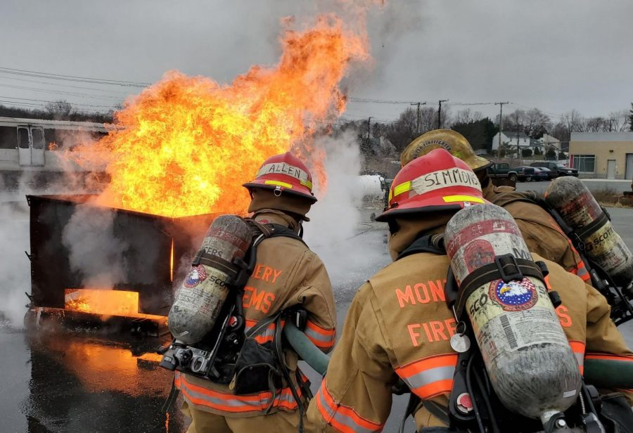 Cadets+at+the+Montgomery+County+Fire+Rescue+Service+Training+Academy+practice+setting+out+a+fire+on+a+car+during+a+%22burn%2C%22+which+lasts+a+full+day.+