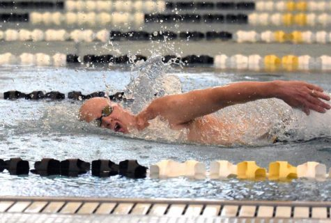 Swim coach John Dissinger works out in the natatorium before school starts. Dissinger trains in his free time for open water races. Last April, he signed up to swim in a race from San Francisco to Alcatraz Island, which is supposed to be held in September.