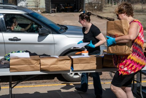 Satanta teachers worked hard to put student's supplies in brown paper bags while wearing personal protective equipment to keep the community safe. This system was set up as a drive-thru so students could get their supplies quickly so the next could do the same.