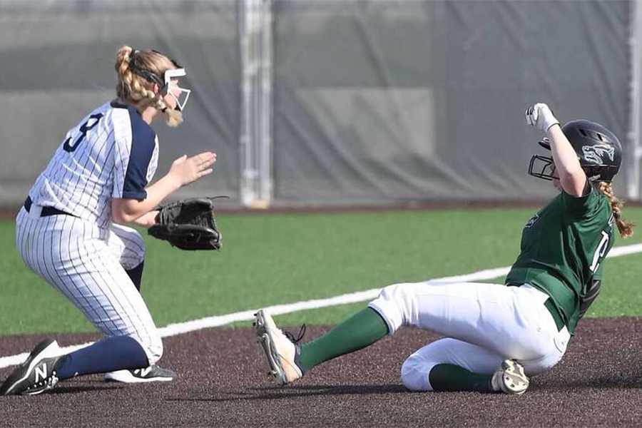 Sliding+into+third+base%2C+senior+outfielder+Katy+Kahlich+gets+into+better+scoring+position+for+the+batter.+Kahlich+has+been+on+the+varsity+softball+team+for+four+years.+%E2%80%9CIt%E2%80%99s+just+disappointing+knowing+we+have+a+lot+of+talent+and+a+lot+of+us+seniors+don%E2%80%99t+get+the+senior+experience%2C%E2%80%9D+Kahlich+said.+%E2%80%9CIt%E2%80%99s+upsetting+just+not+experiencing+not+enjoying+our+final+season.%E2%80%9D