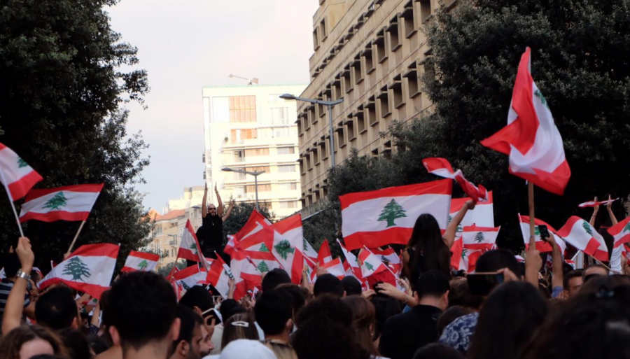 Lebanese+citizens+fill+the+streets+and+wave+the+Lebanese+flag+in+protest+of+taxes+on+internet-based+calls.