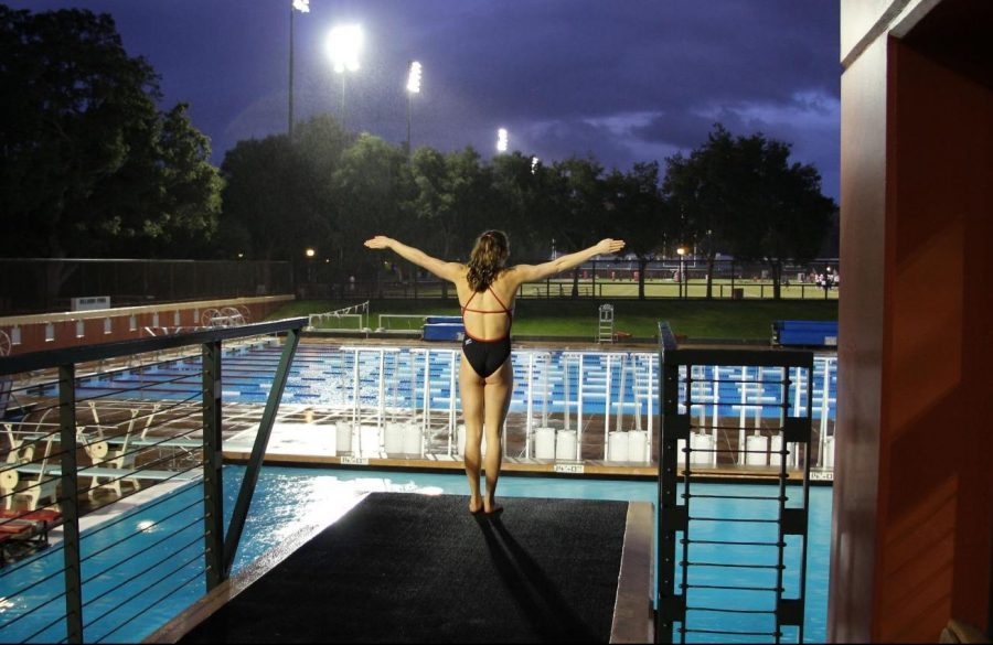 Melina+Dimick%2C+a+senior%2C+stands+at+the+edge+of+the+platform+in+preparation+for+a+dive.+