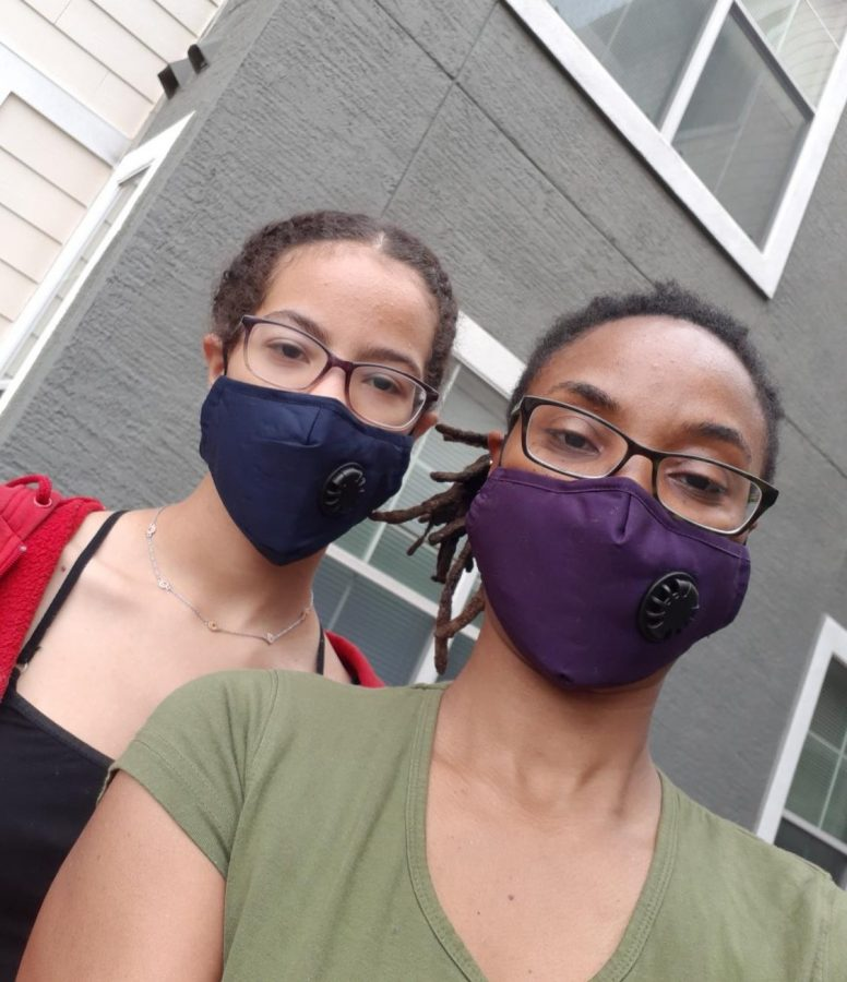TO+GRANDMA%27S+HOUSE+WE+GO%3A+At+the+beginning+of+the+quarantine%2C+my+mom+ordered+masks+online+for+me%2C+herself%2C+my+dad+and+my+grandma.+We+wear+these+masks+anytime+we+are+going+outside+to+do+anything.+This+picture+was+taken+outside+of+my+grandma%27s+apartment+before+we+delivered+her+some+groceries.+Photo+by+Jolie+Gabriel.