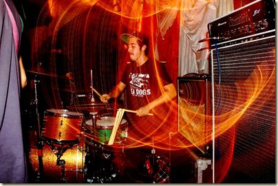 "Daniel Vega plays the drums with his band Zlam Dunk during the band's third tour. Vega said he wasn't sure where and when the photo was taken but his best guess was that it was in Philadelphia in 2011. ""It was the longest tour we ever did,"" Vega recalled, ""roughly five weeks on the road, living in a van and crashing on floors. Best time of my life, other than getting married and teaching at McCallum obviously."" The extended spring break gave the math teacher the chance to realize an album project that has been four years in the making. The album,"