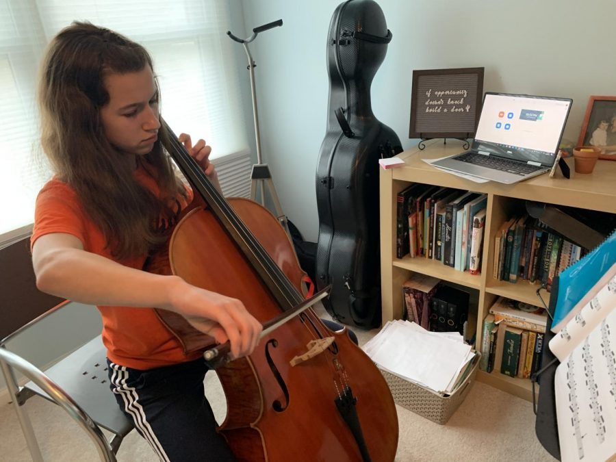 Due+to+social+distancing%2C+music+students+at+home+have+been+doing+private+lessons+remotely+at+home.+Louisa+Hagen%2C+freshman%2C+prepares+to+video+chat+with+her+teacher+through+Zoom+right+before+her+private+lesson.++