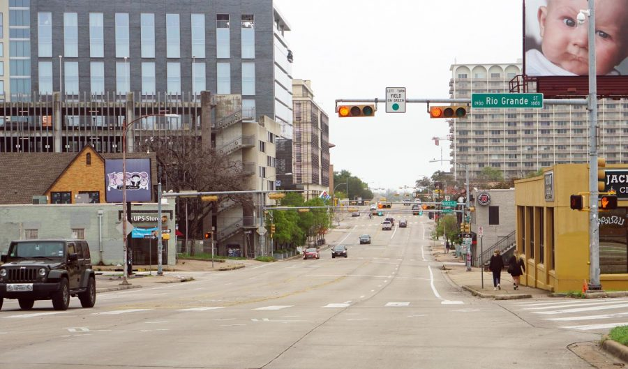 The+decrease+in+transportation+emissions+has+been+a+positive+environmental+impact+as+normally+busy+streets+like+Martin+Luther+King+Jr.+Boulevard+just+south+of+the+UT+campus+have+been+virtually+devoid+of+traffic.+Photo+by+Henry+Winter.
