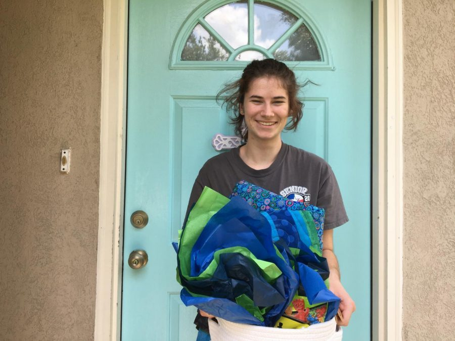 Holding+her+basket+of+gifts%2C+senior+Sarah+Rodriguez+thanks+her+adoption+family.+%22I+got+adopted+through+my+church%2C%22+Rodriguez+said.+%22I+am+so+thankful+for+the+kind+woman+who+chose+me+and+thought+about+how+stressed+we+all+are+right+now.%22+