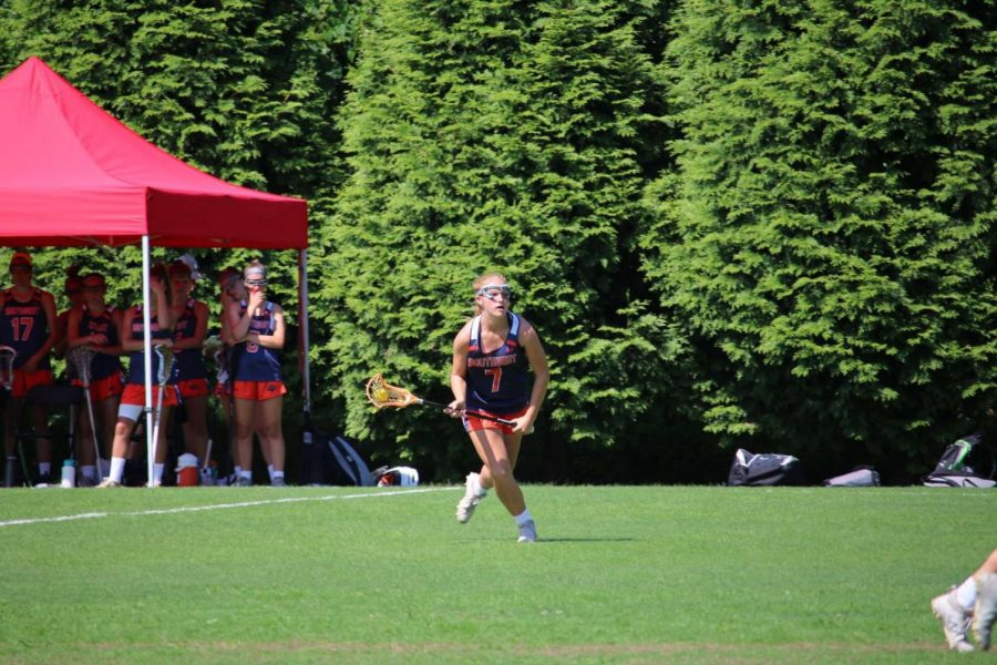 Kate+Marano+jumps+onto+the+field+playing+lacrosse+with+her+team.+