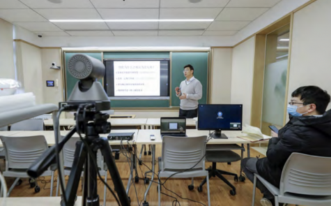 A professor at Peking University in China uses an online educational system to teach physical chemistry classes