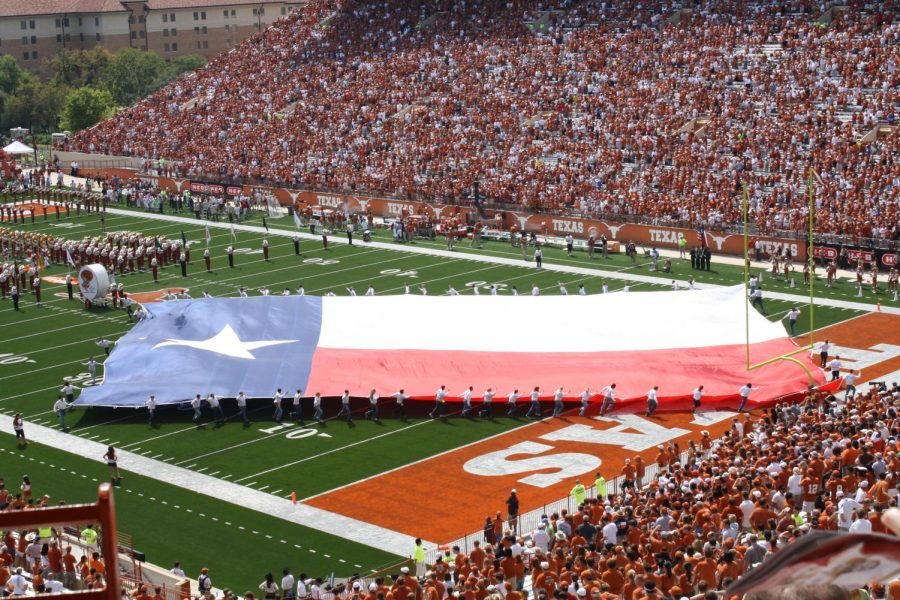 The+Longhorn+Band+performs+at+a+pre-pandemic+football+game.+At+the+Texas+football+season+home+opener+against+UTEP+last+Saturday%2C+the+alma+mater+was+played+over+the+loud+speaker+because+the+band+was+not+in+attendance.+Photo+originally+accessed+on+the+losays+Flickr+account.+Reposted+here+with+permission+under+a+creative+commons+license.