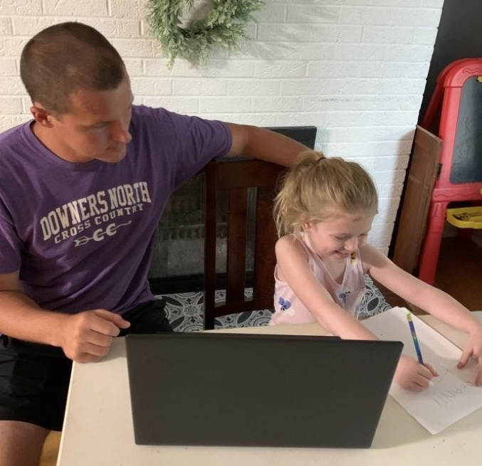 TEACHING+FROM+HOME%3A+science+teacher+Bob+Calder+helps+his+daughter+during+remote+learning.