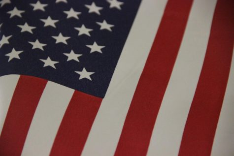 "An American flag hangs in the Eagle Nation Online newsroom. Today, Sept. 11, many students will be looking to classroom flags as they commemorate the 19th anniversary of the events of Sept. 11, 2001. Motivational speaker Sujo John tells his story of 9/11 and how much he loves America in the attached article. ""I've traveled to every state and every city across this country, and I've had the joy of speaking to millions of people and see what this country has been built on,"" John said. ""America is not a perfect country because America is made of the people, and nobody is perfect. But, there is no nation like this country."""