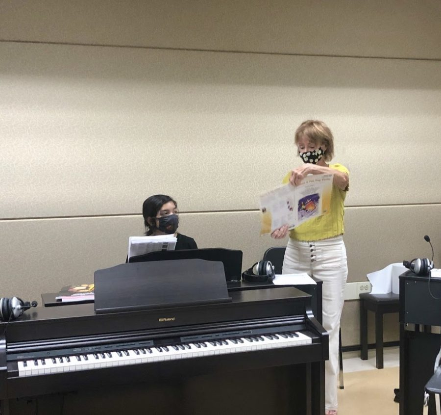 Music student Melody Little receives instruction from Piano 1 professor Gail Pollock during the COVID-19 outbreak. Pollock also said that she disinfects the area with Pledge Antibacterial Surface Cleaner between classes.