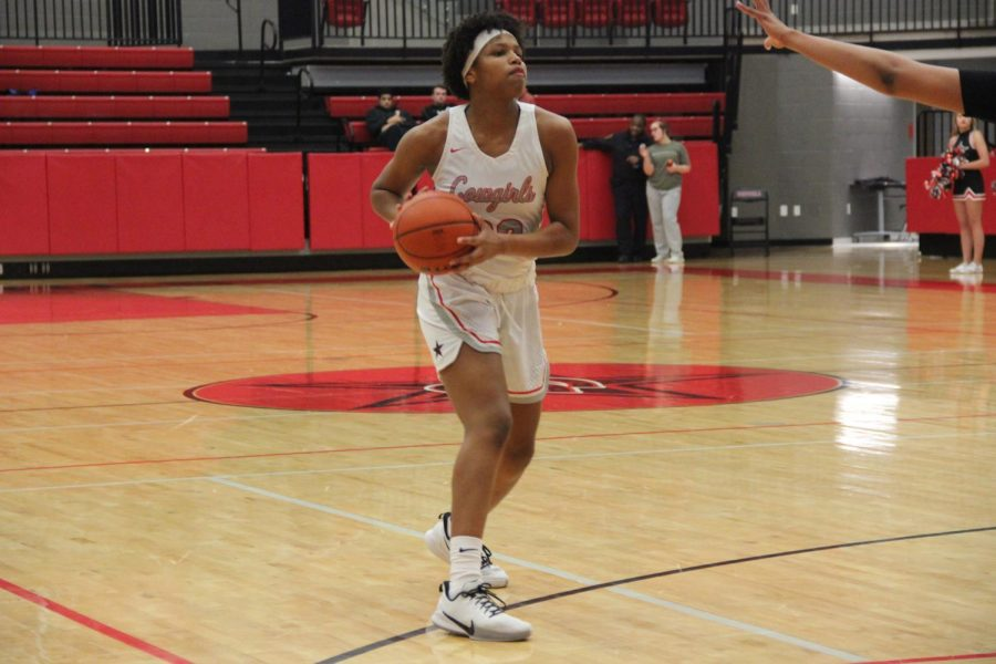 Coppell senior forward India Howard passes against Irving MacArthur on Jan. 21 in the CHS Arena. Howard is one of many students speaking out on social media in support of the NBA strike.