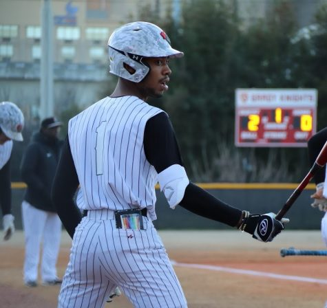 Senior outfielder Christian Smith prepares to step up to the plate in a game.