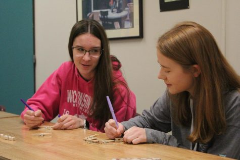 In November 2019, Lancers Helping Lancers organized and executed a mental health week. Seniors Sydney Stinnett and Taylor Wulf help to make clothespins to clip on to unsuspecting student