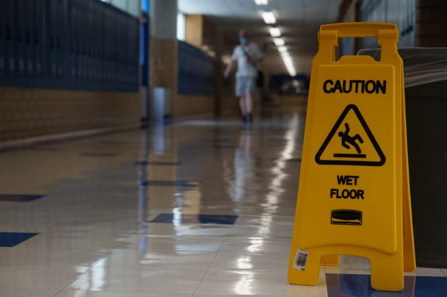 A+caution+sign+stands+in+an+empty+hallway+on+the+Friday+to+end+the+first+week+of+school.+So+far+all+learning+has+been+virtual%2C+but+some+students+will+return+to+campus+starting+Oct.+5.