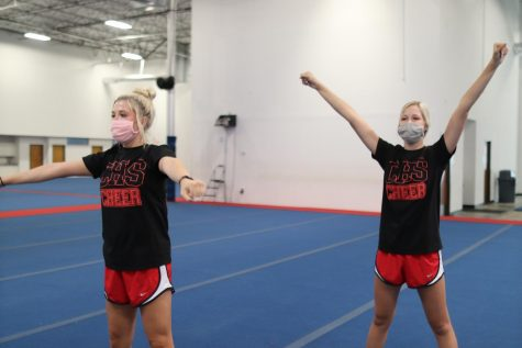 Coppell senior cheerleader Tenley Colclasure and freshman cheerleader Tali Colclasure practice routines at the Spirit of Texas gymnasium on Sept. 28. Despite different athletic backgrounds, the Colclasure sisters are now both a part of the Coppell cheer team.