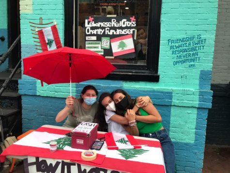L to R: Susan Hammoud, Christina Limansky and Karla Stephan sit outside of Muncheez, DC gathering donations to support the Lebanese Red Cross.